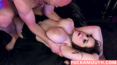 sliding his cock in between her massive mammaries