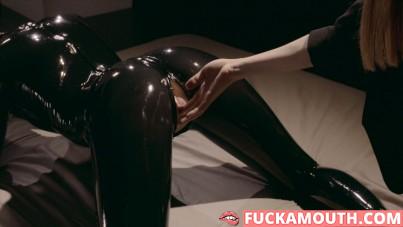 submissive girl in latex cat suit